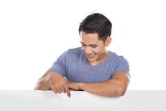 Young asian man holding a blank banner Stock Photos