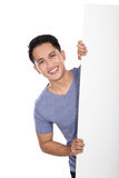 Young asian man holding a blank banner Royalty Free Stock Photo