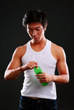 Young asian man holding bottle with water Stock Photography