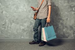 Young asian man hold shopping bag Royalty Free Stock Images