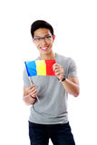 Young asian man holding flag of Romania Stock Photos