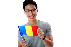 Young asian man holding flag of Romania Royalty Free Stock Images