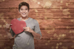 Young asian man holding heart shape Stock Images