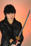 Young asian man holding sword Royalty Free Stock Images