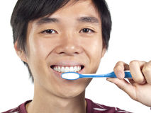 Young Asian man holding toothbrush Stock Photography