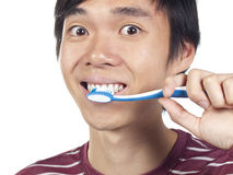 Young Asian man holding toothbrush Stock Photo