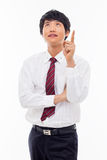 Young asian man indicated up side. Royalty Free Stock Photos