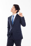 Young asian man indicated up side. Royalty Free Stock Photo