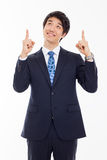 Young asian man indicated up side. Royalty Free Stock Image