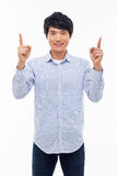 Young asian man indicated upside. Royalty Free Stock Images