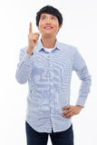 Young asian man indicated upside. Royalty Free Stock Photo