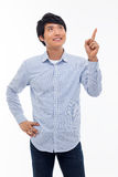 Young asian man indicated upside. Royalty Free Stock Photography