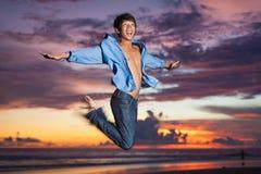 Man jumping. Young asian man jumping at sunset Royalty Free Stock Photo