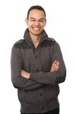 Young asian man laughing with arms crossed Stock Image