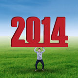 Young asian man lifting 2014 Stock Images