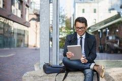 Free Young Asian Man Looking At Digital Tablet Stock Photo - 70812190