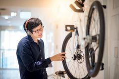 Young Asian man looking for bicycle in bike shop stock photography