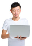 Young asian man looking at laptop Royalty Free Stock Images