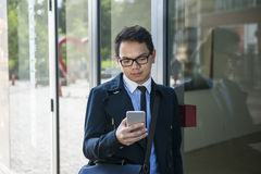 Young asian man looking at mobile phone Royalty Free Stock Image