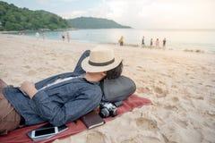 Young Asian man lying on the beach Stock Photos