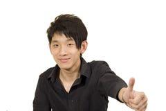 Young Asian man making good Stock Photography