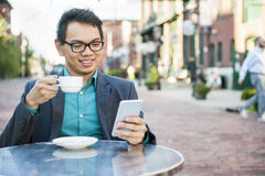 Young asian man in outdoor cafe Stock Photos