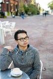 Young asian man in outdoor cafe Stock Photos