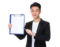 Young asian man pen pointing to clipboard Royalty Free Stock Image