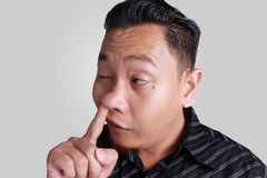 Young Asian Man Picking His Nose Stock Image