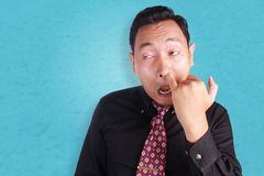 Young Asian Man Picking His Nose Stock Photo