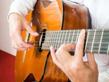 Young Asian man play guitar. Classical music instrument. String music equipment. Royalty Free Stock Image