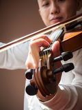 Young Asian man play violin. Classical music instrument. Art and music portrait background. Warm color tone. Young Asian man play violin. Classical music Royalty Free Stock Photography