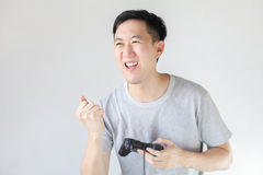 Young Asian man playing video games Stock Images