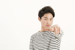 Young asian man pointing at you Royalty Free Stock Images