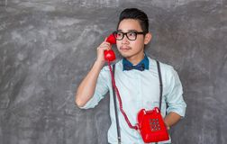 Young asian man portrait with telephone Stock Photos