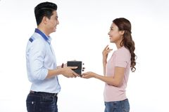 Young Asian man propose to his girlfriend isolated on white back. Happy young Asian men propose to his girlfriend, studio shot isolated on white background stock photos