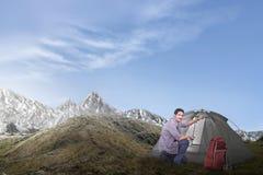 Young asian man set up a tent royalty free stock photos