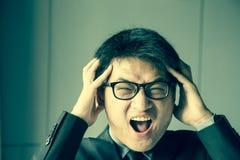 Young asian man shouting Stock Photo