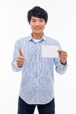 Young asian man showing empty card and showing thumb. Stock Image