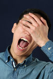 Young Asian man showing facepalm Royalty Free Stock Photo