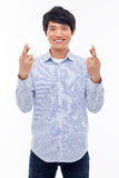 Young Asian man showing fist and happy sign. Stock Photography