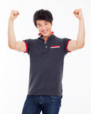 Young Asian man showing fist and happy sign. Royalty Free Stock Image