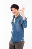 Young asian man showing okay sign. Royalty Free Stock Image
