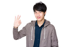 Young asian man showing okay sign Stock Images