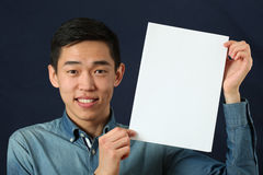 Young Asian man showing white copy space page Stock Photo