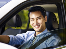 Young asian man sitting in a car smiling Stock Photography