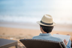 Young asian man sitting and looking to the sea royalty free stock images