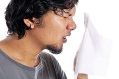 Young asian man sneezing Royalty Free Stock Photos