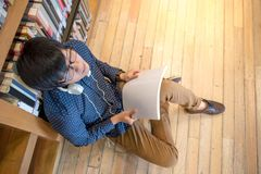 Young Asian man university student in library. Young Asian man student reading book in library, education research and self learning in university life concepts Royalty Free Stock Photography