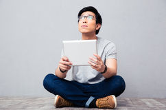Young asian man with tablet computer Stock Image